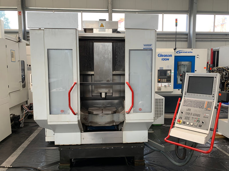 total view on CNC 5-axis machining centre HERMLE C 30 U built 2004 with NC swivel rotary table