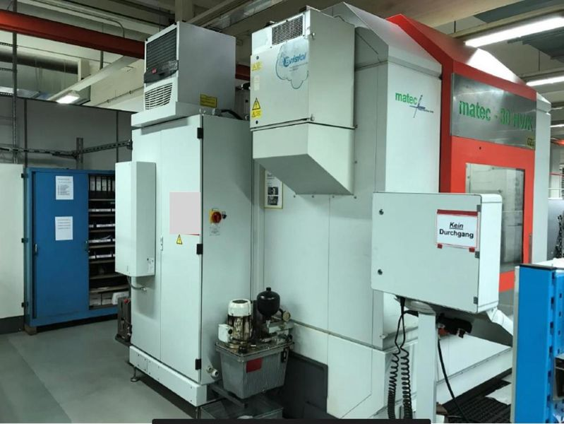 switch cabinet, coolant unit and suction of 5-axis machining centre MATEC 30 HV/K with HEIDENHAIN iTNC 530, 5-axis and integrated rotary table